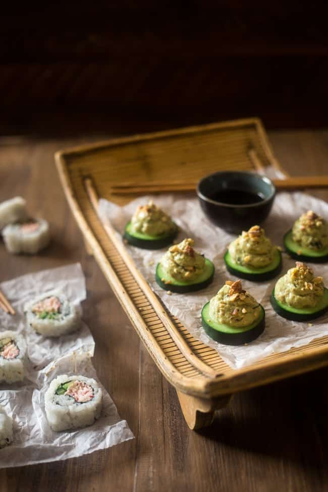 Low Carb California Roll Sushi Bites - Made of creamy Greek yogurt, avocado and crab meat and topped on a cucumber. They're a healthy, low carb and gluten free snack, or appetizer, that tastes like an California Roll, for only 40 calories! | Foodfaithfitness.com | @FoodFaithFit
