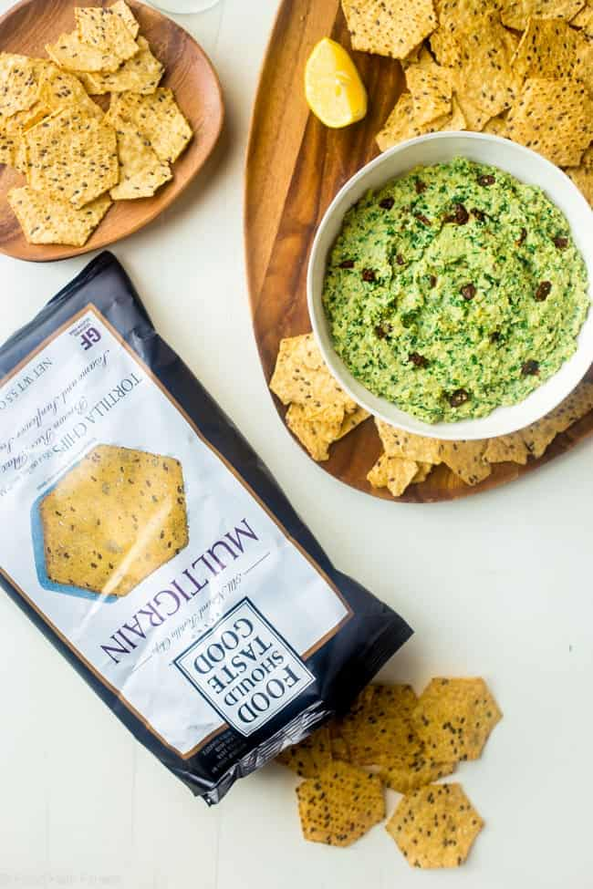 Vegan Kale Pesto Easy Homemade Hummus without Tahini - This quick and easy, vegan homemade hummus features kale pesto and sun dried tomatoes. It's a healthy, gluten free appetizer or snack! | #Foodfaithfitness | #Vegan #Glutenfree #healthy #appetizer