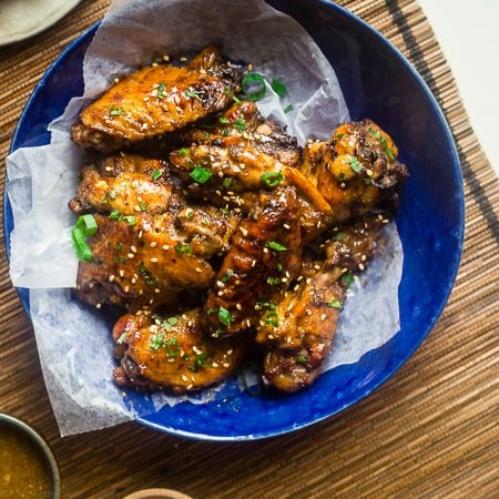 Whole30 Sticky Pineapple 5 Spice Slow Cooker Chicken Wings - Let the slow cooker do the work for you with these Asian-inspired chicken wings! You'll never know they're secretly whole30 and paleo compliant! Perfect for game day!   Foodfaithfitness.com   @FoodFaithFit