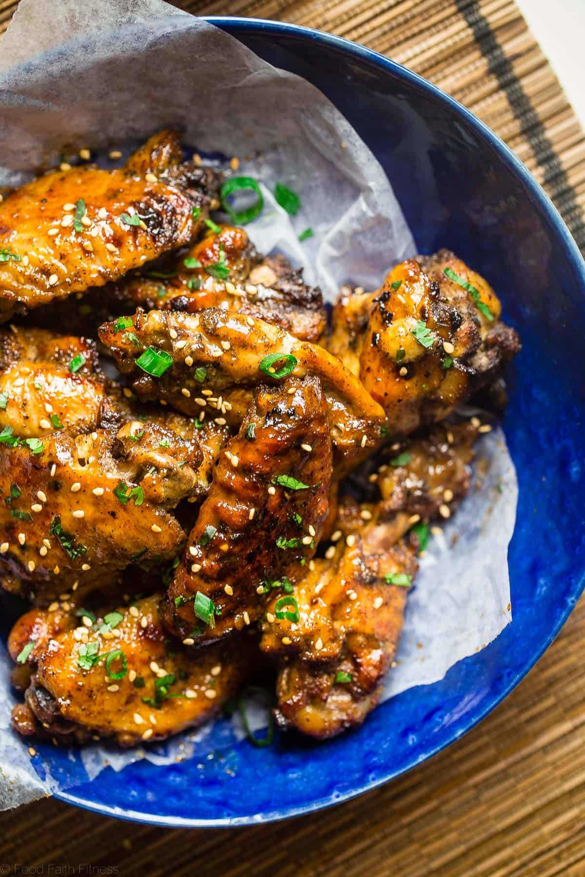 close up photo of slow cooker wings in a blue bowl