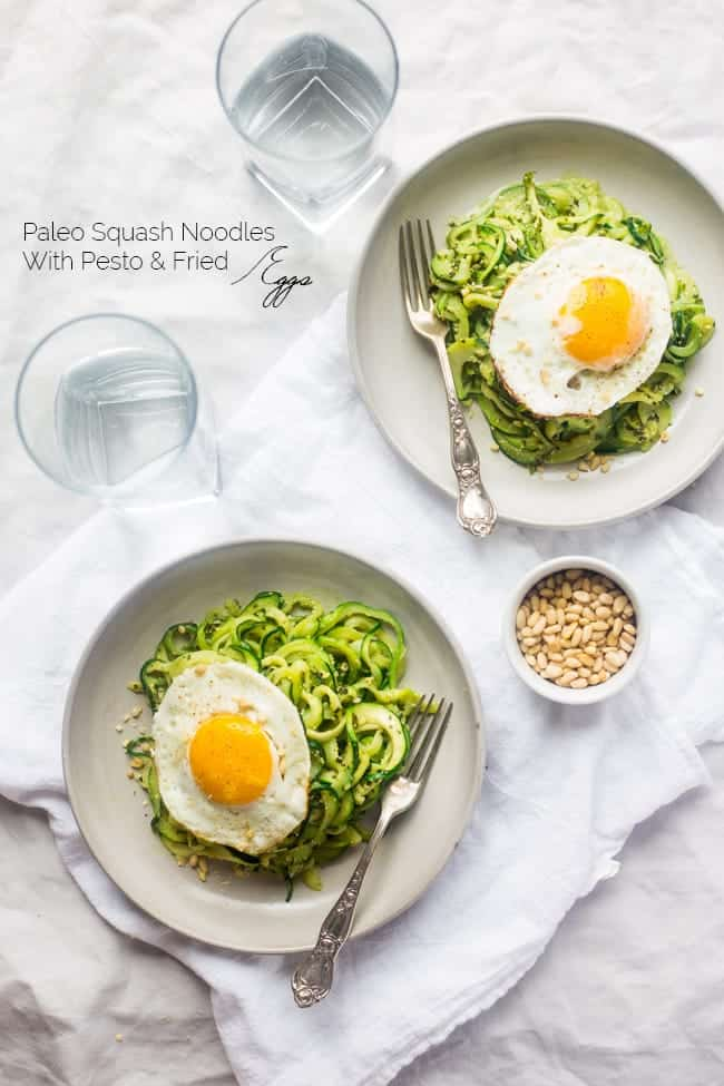 Whole30 Paleo Zucchini Noodles with Everything Pesto and Fried Eggs - Zucchini noodles are mixed with creamy pesto and then topped with fried eggs. It's an easy, light and healthy, meatless weeknight dinner!   Foodfaithfitness.com   @FoodFaithFit