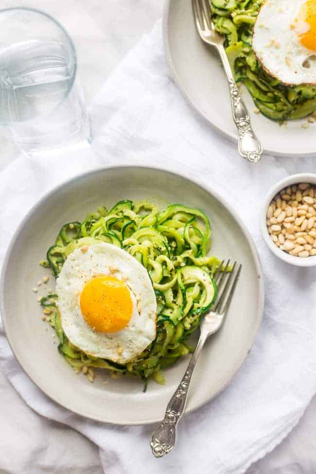 zucchini noodles with pesto on a plate