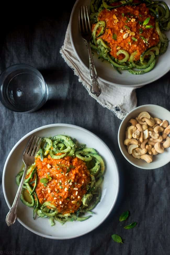 Vegan Lentil Coconut Curry with Cashew Cilantro Pesto Cucumber Noodles - Spiralized cucumbers are mixed with a flavorful pesto and then topped with creamy lentil coconut curry for a healthy, vegan friendly, weeknight meal! | Foodfaithfitness.com | @FoodFaithFit