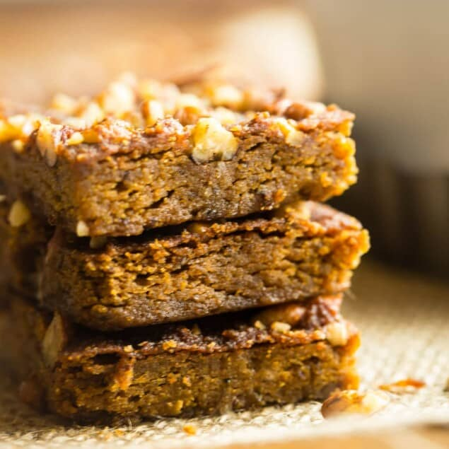 Gluten Free Vegan Carrot Cake Blondies - These carrot cake blondies are dense, chewy and spicy-sweet! You'd never know they're a healthy, paleo-friendly treat for only 100 calories! Perfect for Easter! | Foodfaithfitness.com | @FoodFaithFit