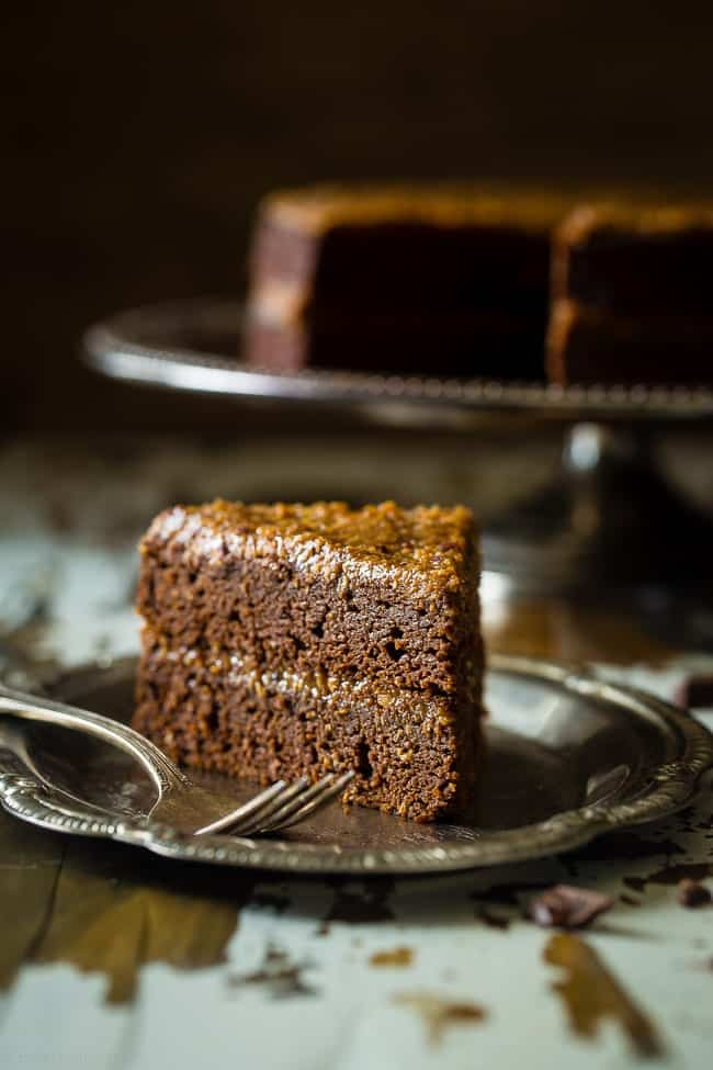 Paleo German Chocolate Cake - You'd never know this rich, moist German Chocolate Cake is a healthy remake that is paleo friendly and gluten, grain, oil, butter and refined sugar free!   Foodfaithfitness.com   @FoodFaithFit