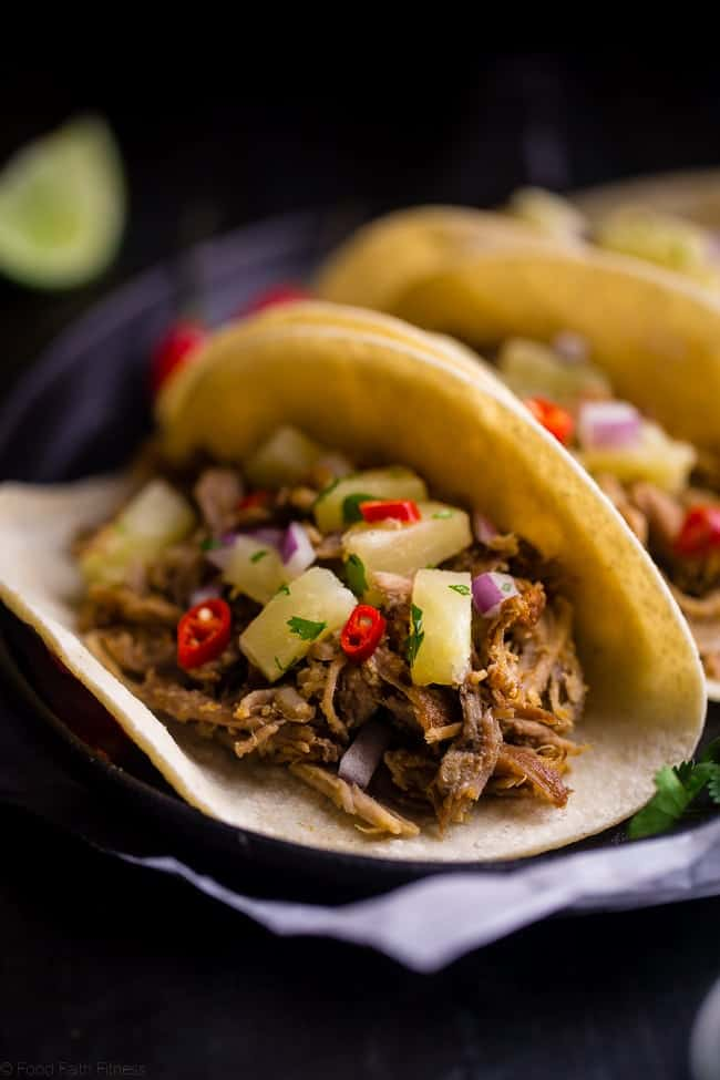 Slow Cooker Green Curry Pork Tacos - These pork tacos have the spicy-sweet taste of Thai curry and pineapple salsa! They're made in the slow cooker for an easy, gluten free and healthy meal! | Foodfaithfitness.com | @FoodFaithFit