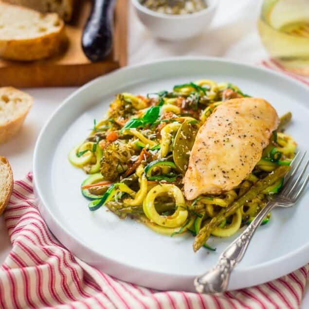 Slow Cooker Italian Chicken with Zucchini Noodles - This easy slow cooker Italian chicken is served over zucchini noodles for a light and healthy, gluten free, spring meal that's under 350 calories! | Foodfaithfitness.com | @FoodFaithFit