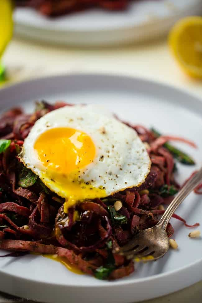 Spiralized Turnip and Beet Salad with Pesto and Fried Eggs - Turnip and beet noodles, fresh pesto and fried eggs make this whole 30 and paleo friendly recipe, that's perfect for spring and under 300 calories! | Foodfaithfitness.com | @FoodFaithFit