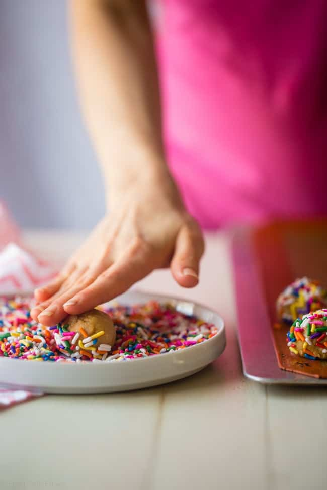 Funfetti Protein Cookie Recipe - These quick and easy cookies taste just like funfetti cake! You'll never know they're a healthy, protein-packed and gluten free treat for under 90 calories and 3 SmartPoints! | Foodfaithfitness.com | @FoodFaithFit