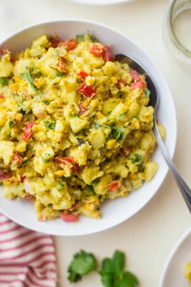 Vegan Mexican Sweet Potato Salad - This easy Mexican sweet potato salad has a spicy avocado chipotle dressing and grilled corn! It's a simple, gluten free and vegan-friendly side dish!   Foodfaithfitness.com   @FoodFaithFit