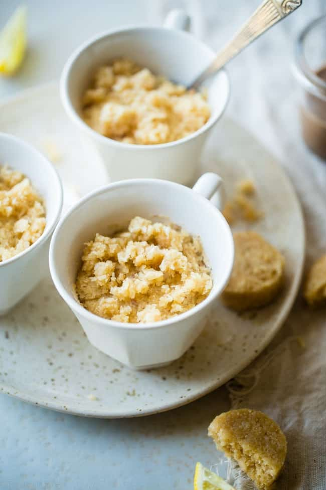 Gluten Free Lemon Macaroon Vegan Mug Cake - Have cookies IN your cake with this easy, gluten free vegan mug cake with coconut flour that's mixed with crumbled up lemon macaroons. It's a healthy dessert that's ready in under 5 minutes!   Foodfaithfitness.com   @FoodFaithFit