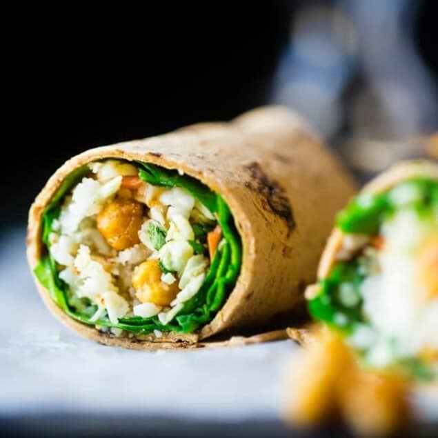 "Vegan ""Honey"" Garlic Chickpea and Cauliflower Rice Wrap - This healthy wrap has an Asian flair with crunchy ""honey"" garlic roasted chickpeas and cauliflower rice! It's a quick and easy, portable and vegan friendly meal that's perfect for lunchboxes! 