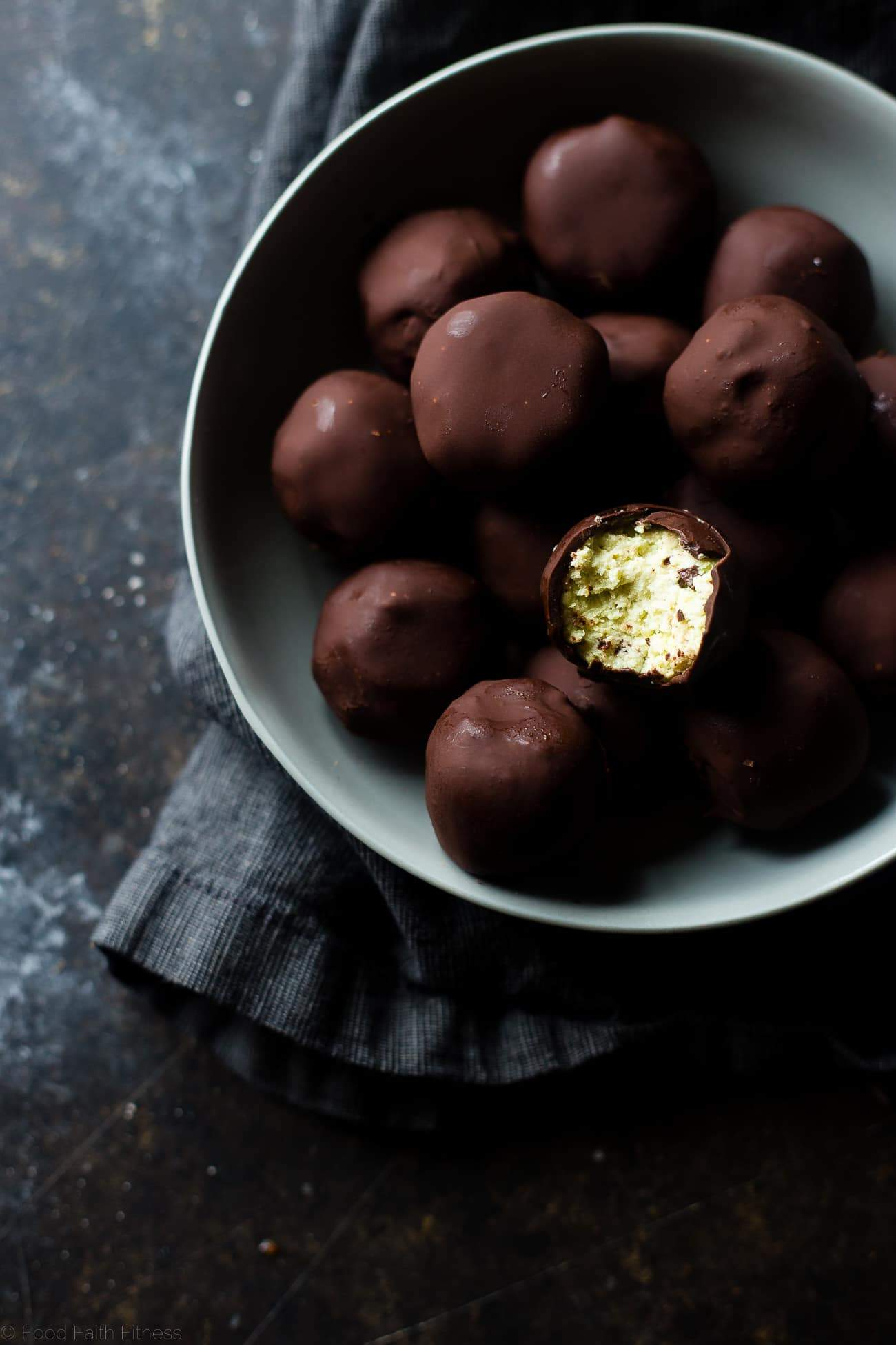 Mint Avocado Cheesecake Truffles - These low carb, protein-packed, creamy cheesecake truffles are covered in chocolate! They're a healthy, gluten free Christmas treat for only 90 calories! | Foodfaithfitness.com | @FoodFaithFit