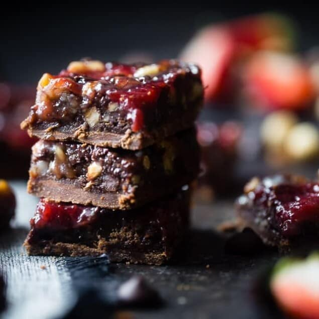 Strawberry Chocolate Paleo Magic Cookie Bars - These magic cookie bars have a sweet strawberry swirl and are SO easy to make! They're a healthy, vegan friendly and gluten free remake of the classic recipe that everyone will love!   Foodfaithfitness.com   @FoodFaithFit