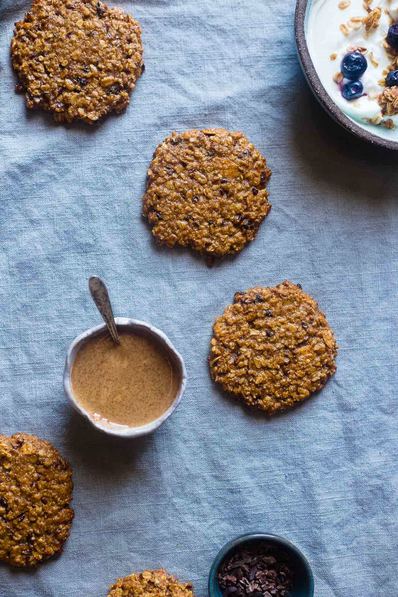 Gluten Free Granola Oatmeal Breakfast Cookies - These kid-friendly healthy breakfast cookies use granola for added crunch! They're gluten and egg free, made in one bowl and are great for busy mornings!   Foodfaithfitness.com   @FoodFaithFit