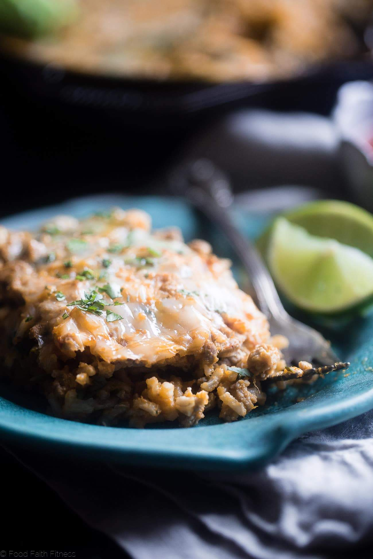 One Pot Mexican Chicken Rice Casserole - This chicken Mexican rice casserole uses sweet potato for extra creaminess! It's a healthy, gluten free, 8 ingredient dinner for busy weeknights that is only 330 calories! | Foodfaithfitness.com | @FoodFaithFit
