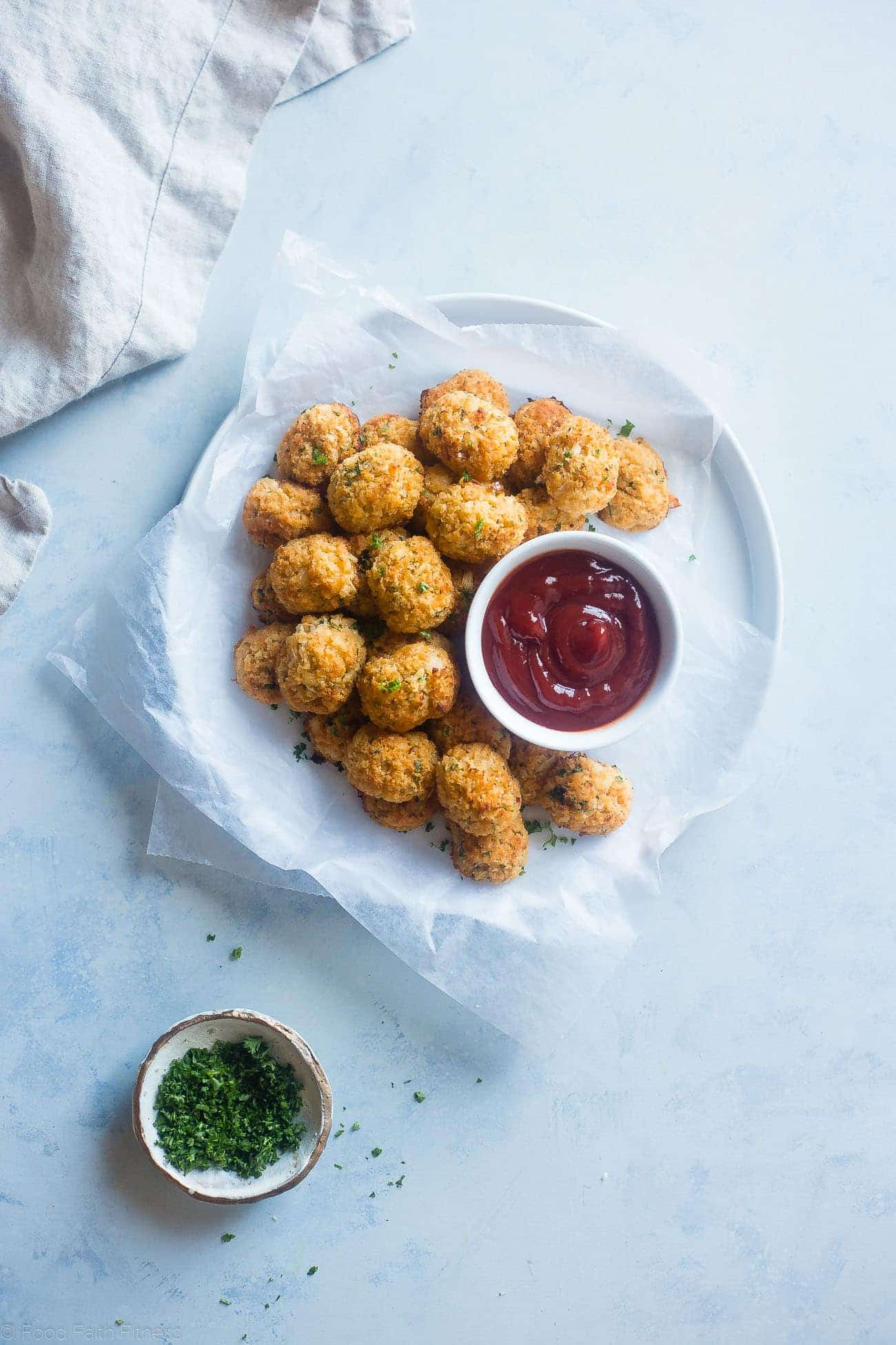 Baked Cauliflower Tater Tots - A gluten free, lower carb version of the classic comfort food that are crispy on the outside and soft on the inside. You'll never know they're healthy and made from hidden veggies! | Foodfaithfitness.com | @FoodFaithFit