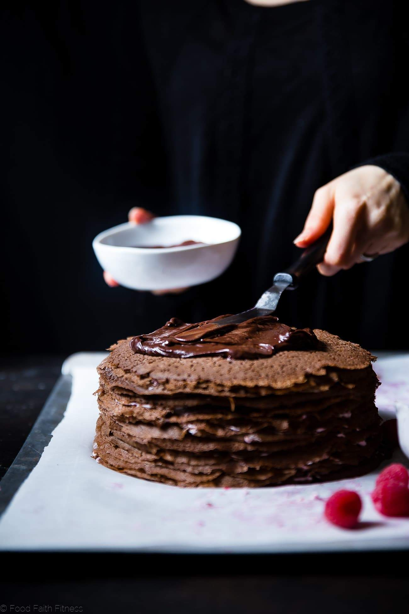 Raspberry Chocolate Vegan Crepe Cake - These crepe cake is made of chocolate crepes layered with raspberries and creamy coconut! It's an impressive healthier, gluten and dairy free dessert that everyone will love! | Foodfaithfitness.com | @FoodFaithFit