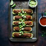 Tuna Zucchini Boats on a baking tray with lime and sauce