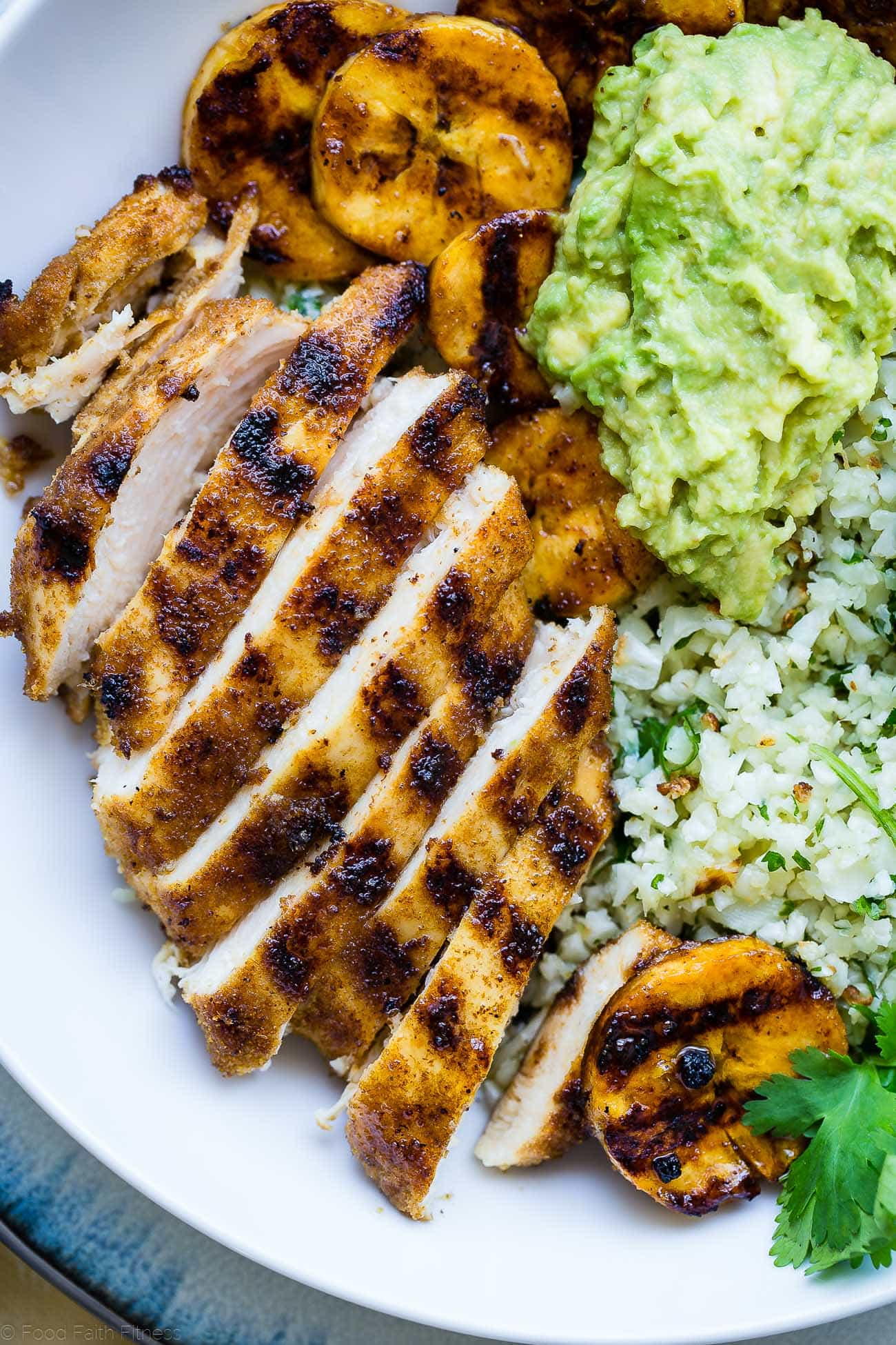 Caribbean Chicken Bowls - These paleo-friendly bowls have grilled plantains, cauliflower rice and avocado! A healthy, gluten free summer meal for under 500 calories! | #Foodfaithfitness | #Paleo #Glutenfree #Healthy #chickenrecipe