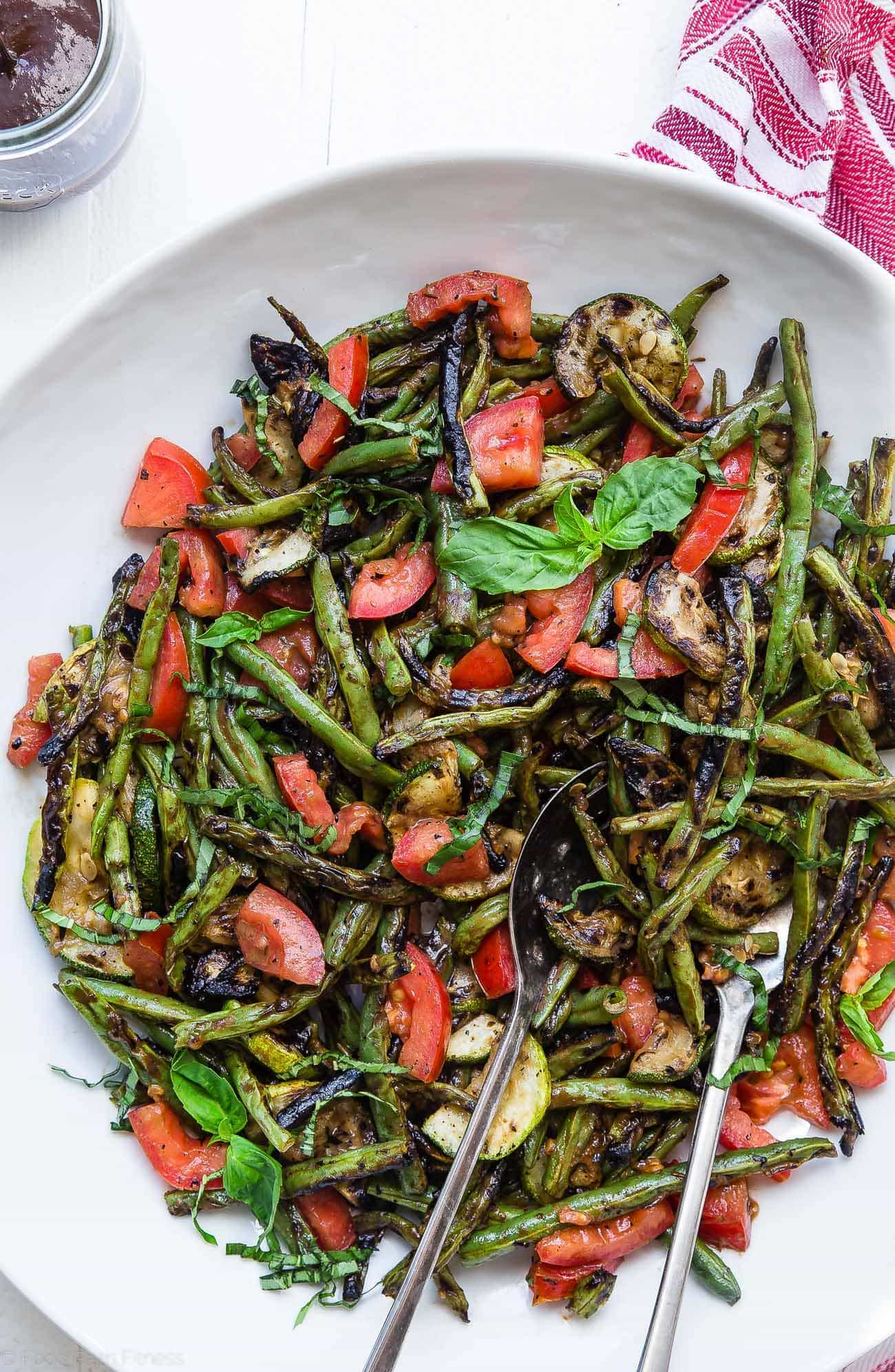 Close up of grilled zucchini and green bean salad. Recipe on Foodfaithfitness.com