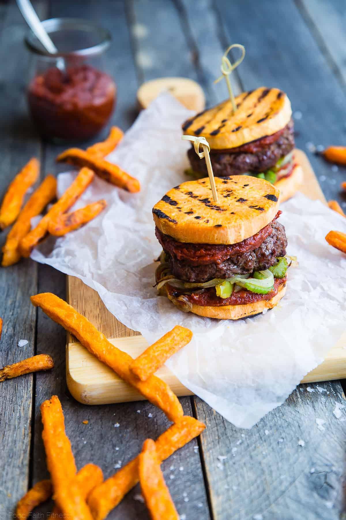 sweet potato bun cajun burger on a meat serving block with fries