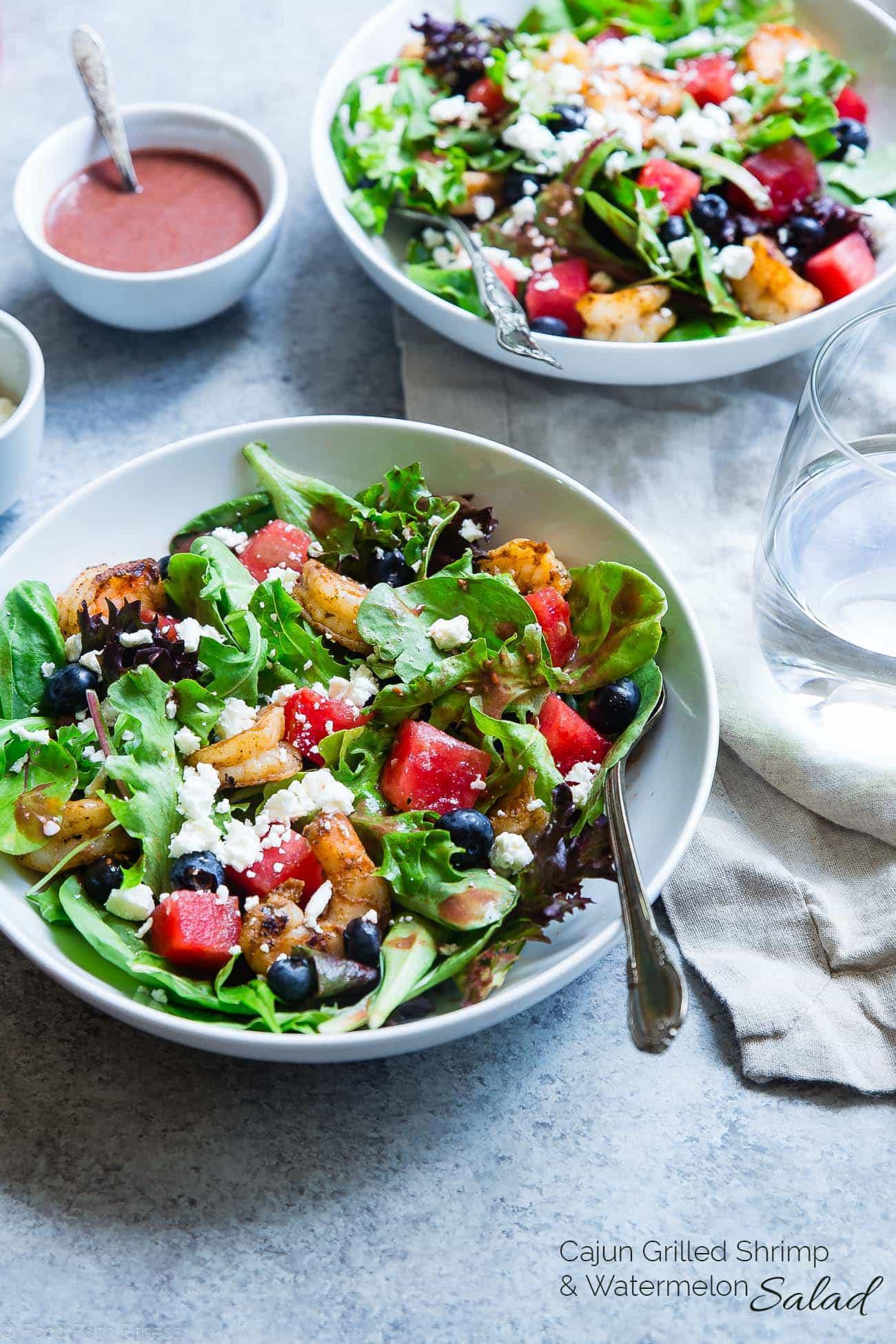 Close up photo of watermelon feta salad with cajun shrimp. Recipe on Foodfaithfitness.com