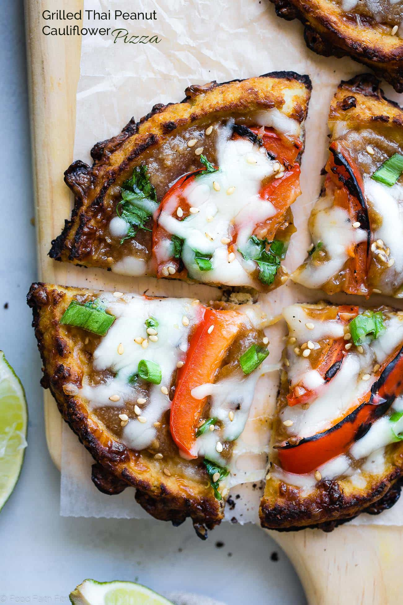 Closeup overhead shot of Thai cauliflower pizza cut into 4 pieces. Recipe on Foodfaithfitness.com