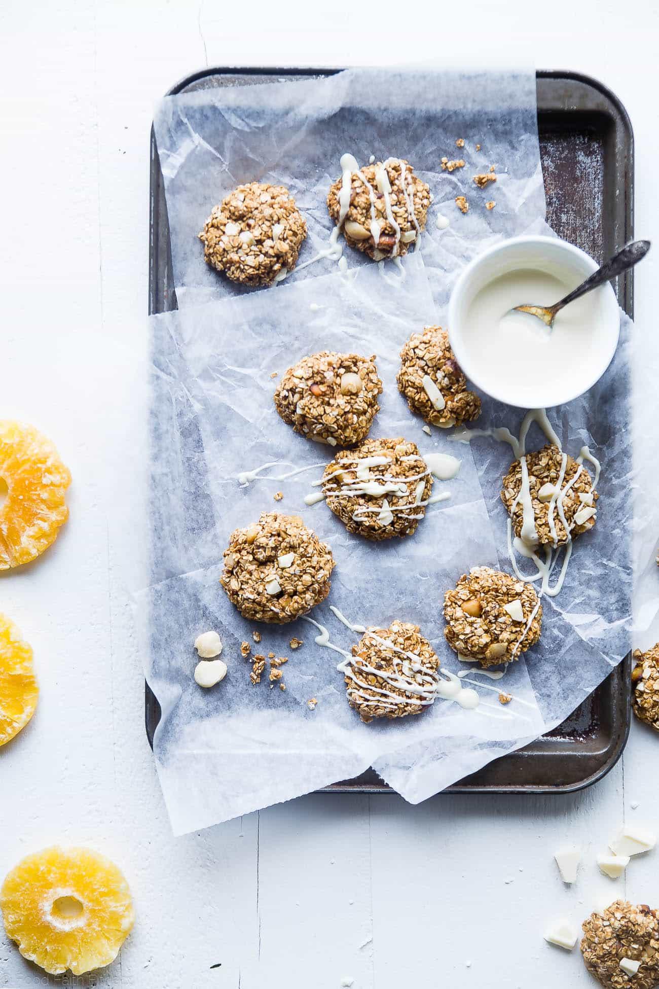 Aerial view of No bake white chocolate macadamia nut cookies on a cookie sheet. Recipe on Foodfaithfitness.com