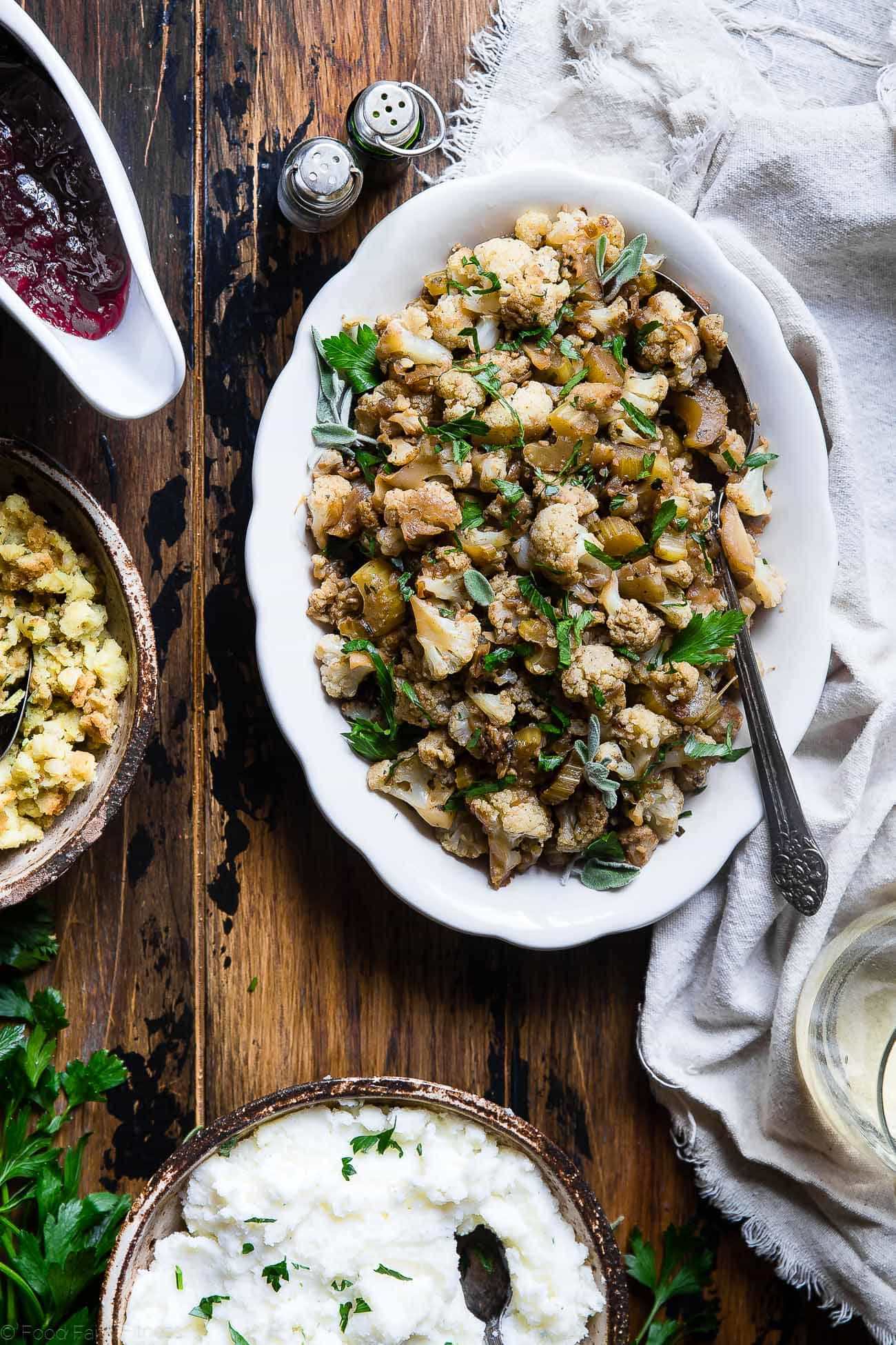 Cauliflower Low Carb Paleo Vegan Stuffing - Made entirely from vegetables but has all the flavor of traditional bread stuffing! It's super easy, whole30 compliant, paleo, vegan, gluten free and SO delicious! Perfect for Thanksgiving or Christmas! | Foodfaithfitness.com | @FoodFaithFit
