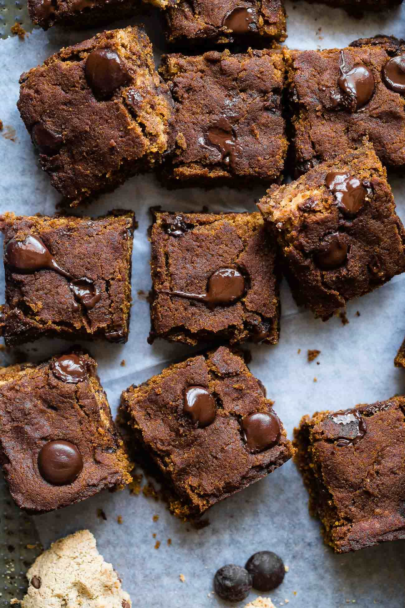 Cookie Stuffed Chewy Pumpkin Blondies -Cookies are baked right inside these healthier pumpkin brookies! They're so dense and chewy you'll never know they're gluten and dairy free! | Foodfaithfitness.com | @FoodFaithFit
