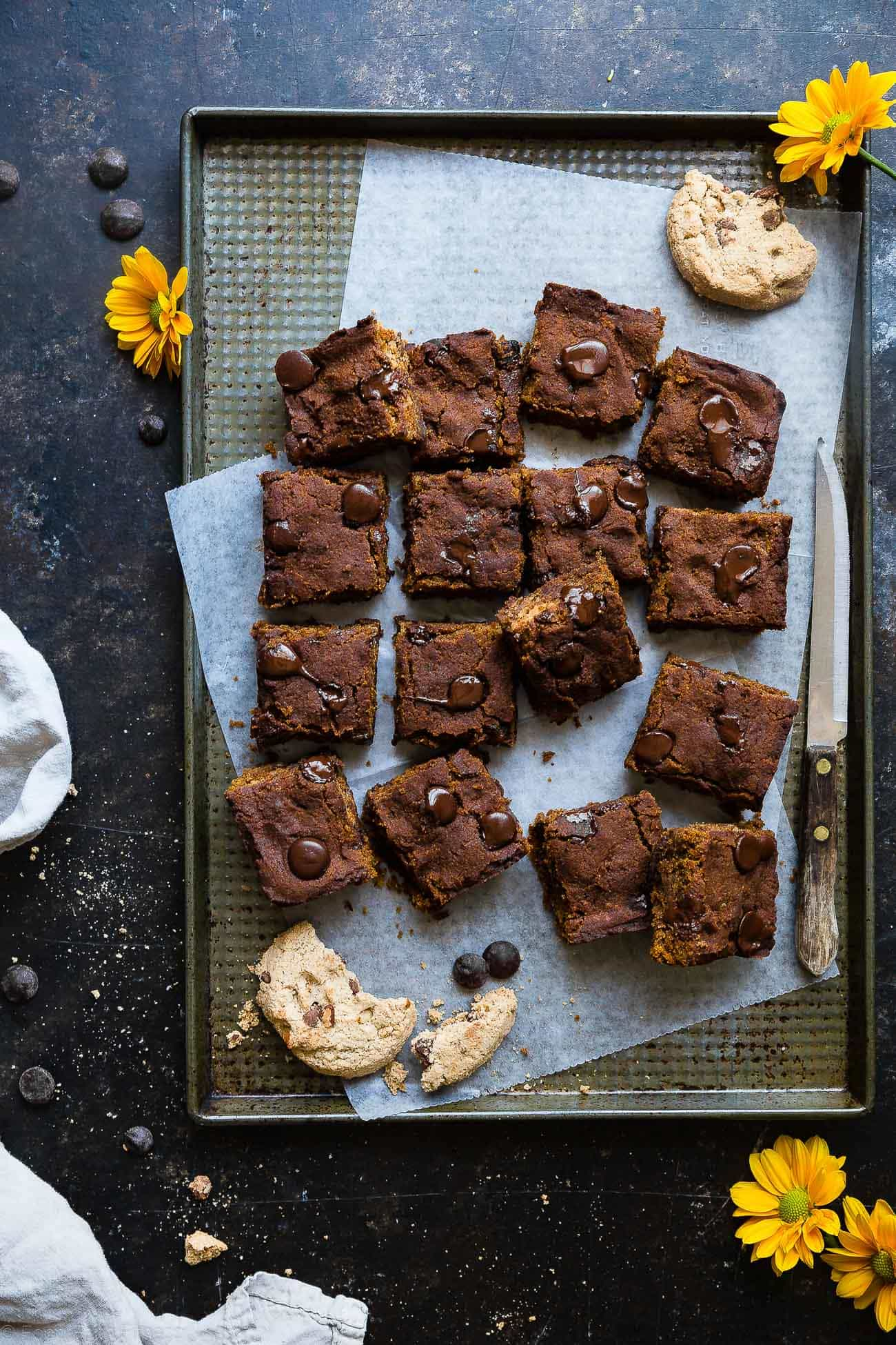 Cookie Stuffed Healthy Pumpkin Blondies -Cookies are baked right inside these healthier pumpkin brookies! They're so dense and chewy you'll never know they're gluten and dairy free! | Foodfaithfitness.com | @FoodFaithFit