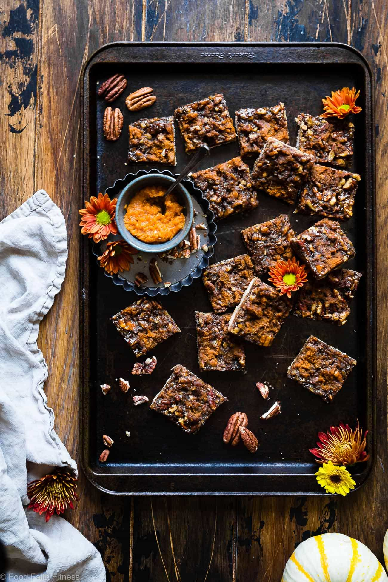 Pumpkin Spice Paleo Vegan Pecan Pie Bars -These easy vegan pecan pie bars are only 8 ingredients and have a pumpkin spice spin! A gluten/grain/dairy/egg free dessert for Thanksgiving that's paleo friendly! | Foodfaithfitness.com | @FoodFaithFit