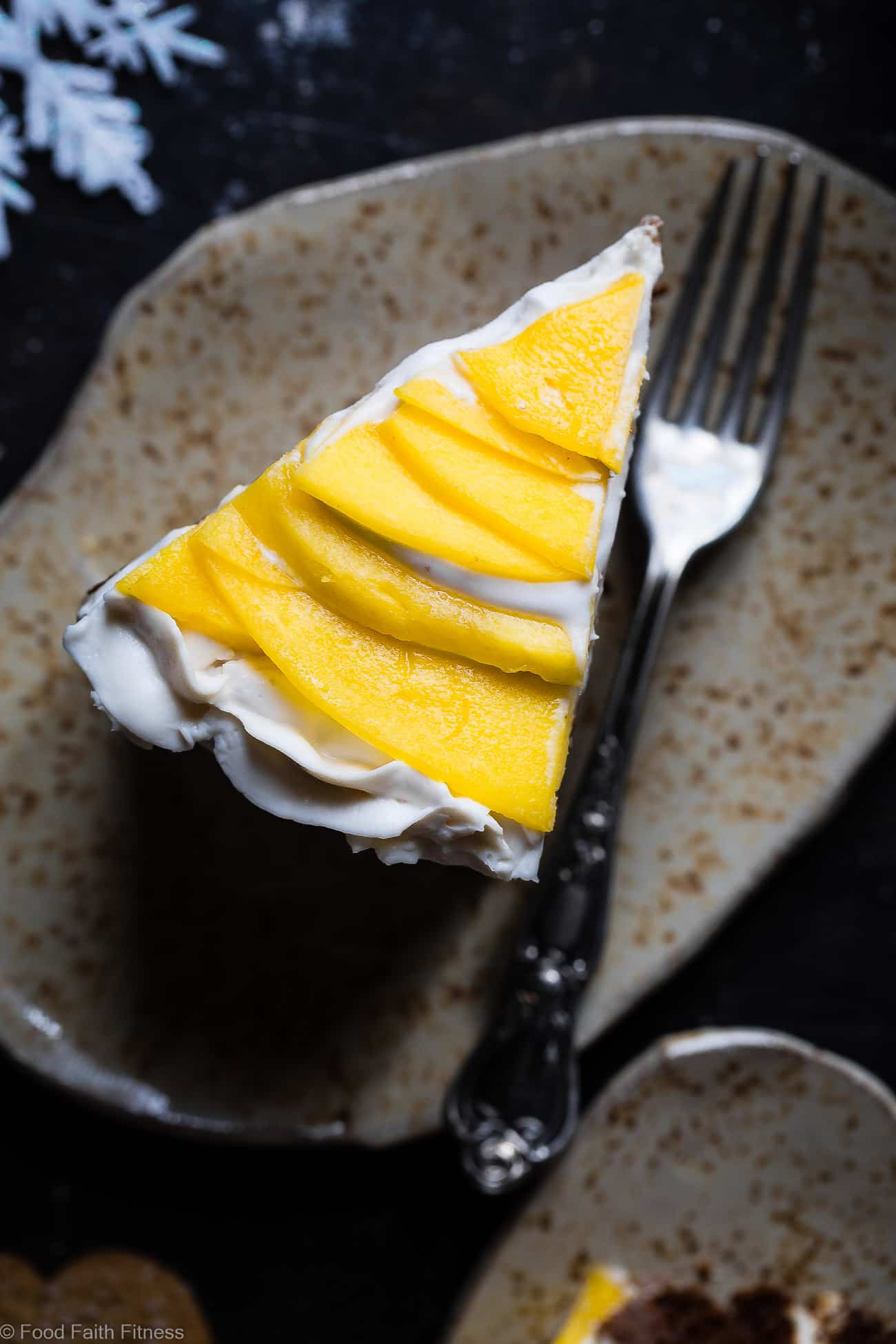 Gluten Free Mango Gingerbread Cake with Coconut Cream - This spicy-sweet, show stopping gluten free gingerbread recipe is studded with juicy, fresh mangoes to create a healthy, paleo-friendly, festive dessert for the Holidays! | Foodfaithfitness.com | @FoodFaithFit