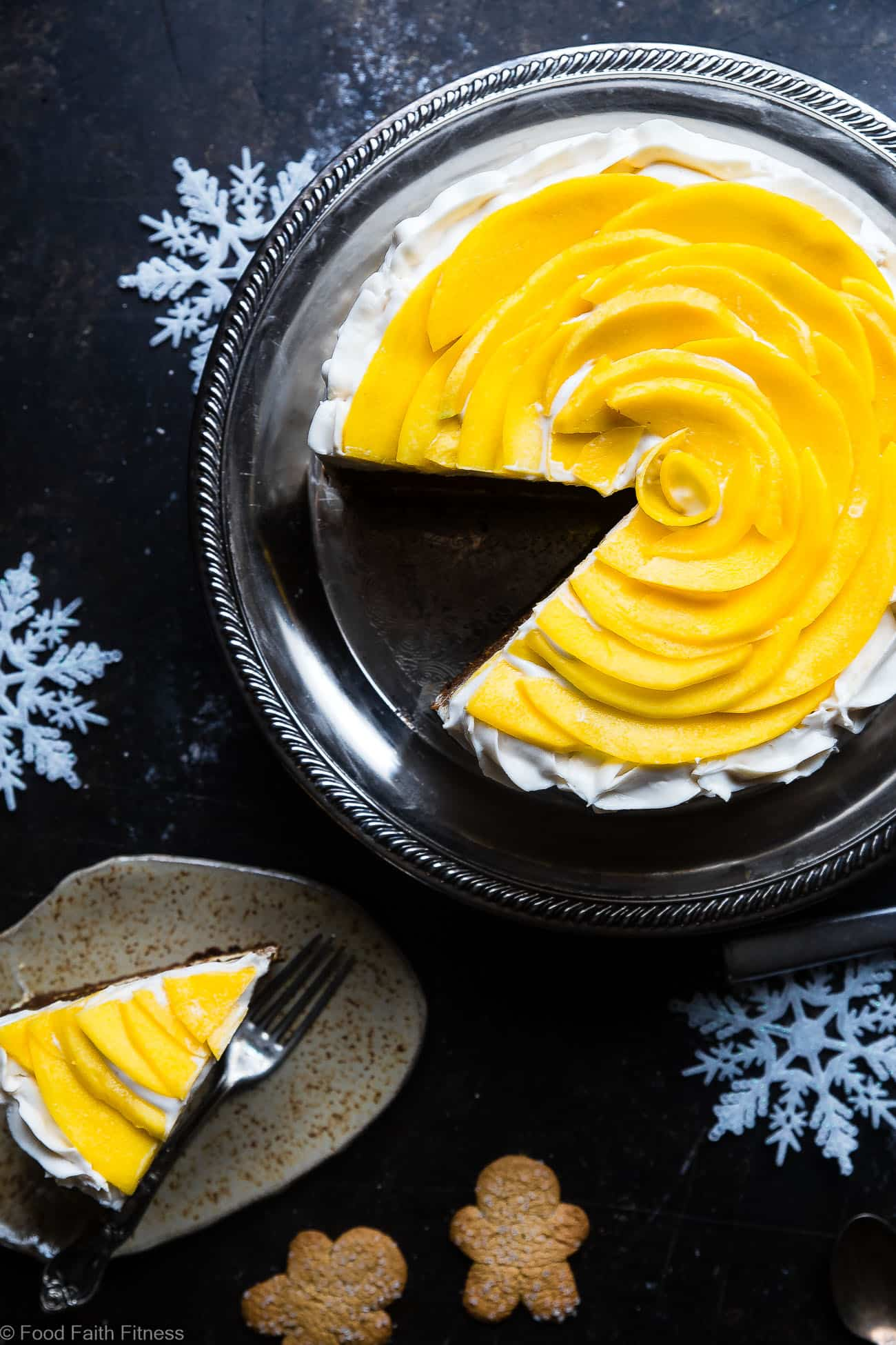 Gluten Free Mango Gingerbread Cake with Coconut Cream - This spicy-sweet, show stopping gluten free gingerbread cake is studded with juicy, fresh mangoes to create a healthy, paleo-friendly, festive dessert for the Holidays! | Foodfaithfitness.com | @FoodFaithFit