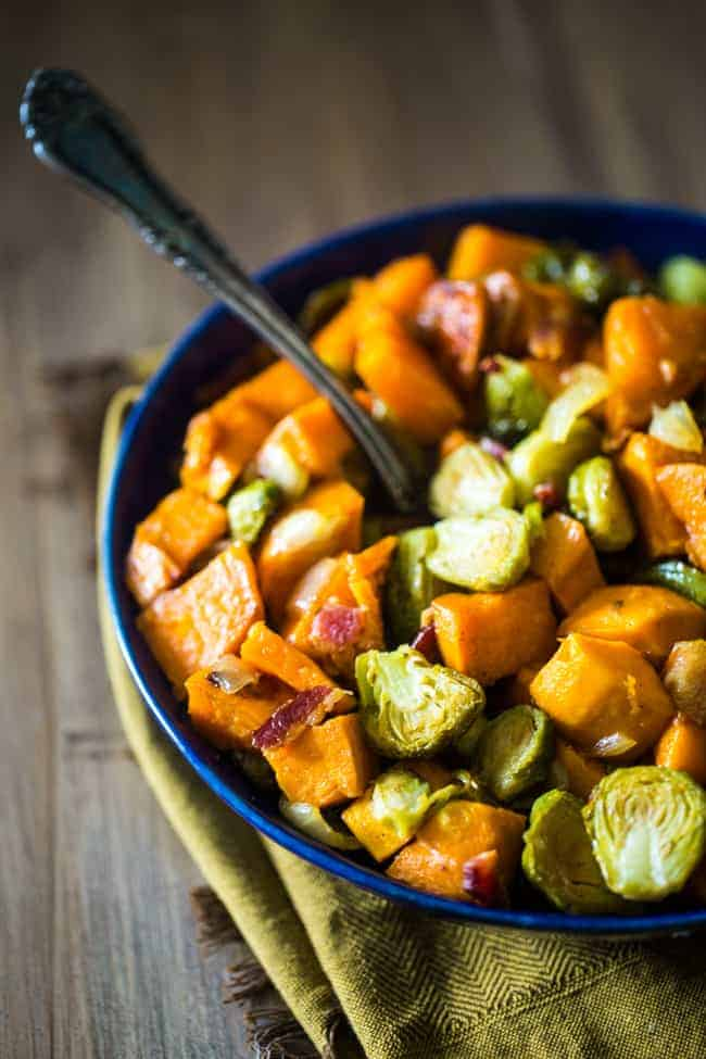 oven roasted maple bacon brussels sprouts and sweet potatoes in a bowl