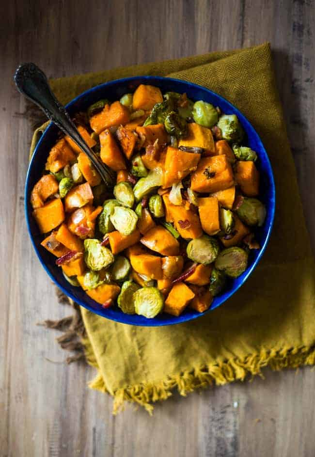a bowl of the best brussels sprouts with sweet potatoes