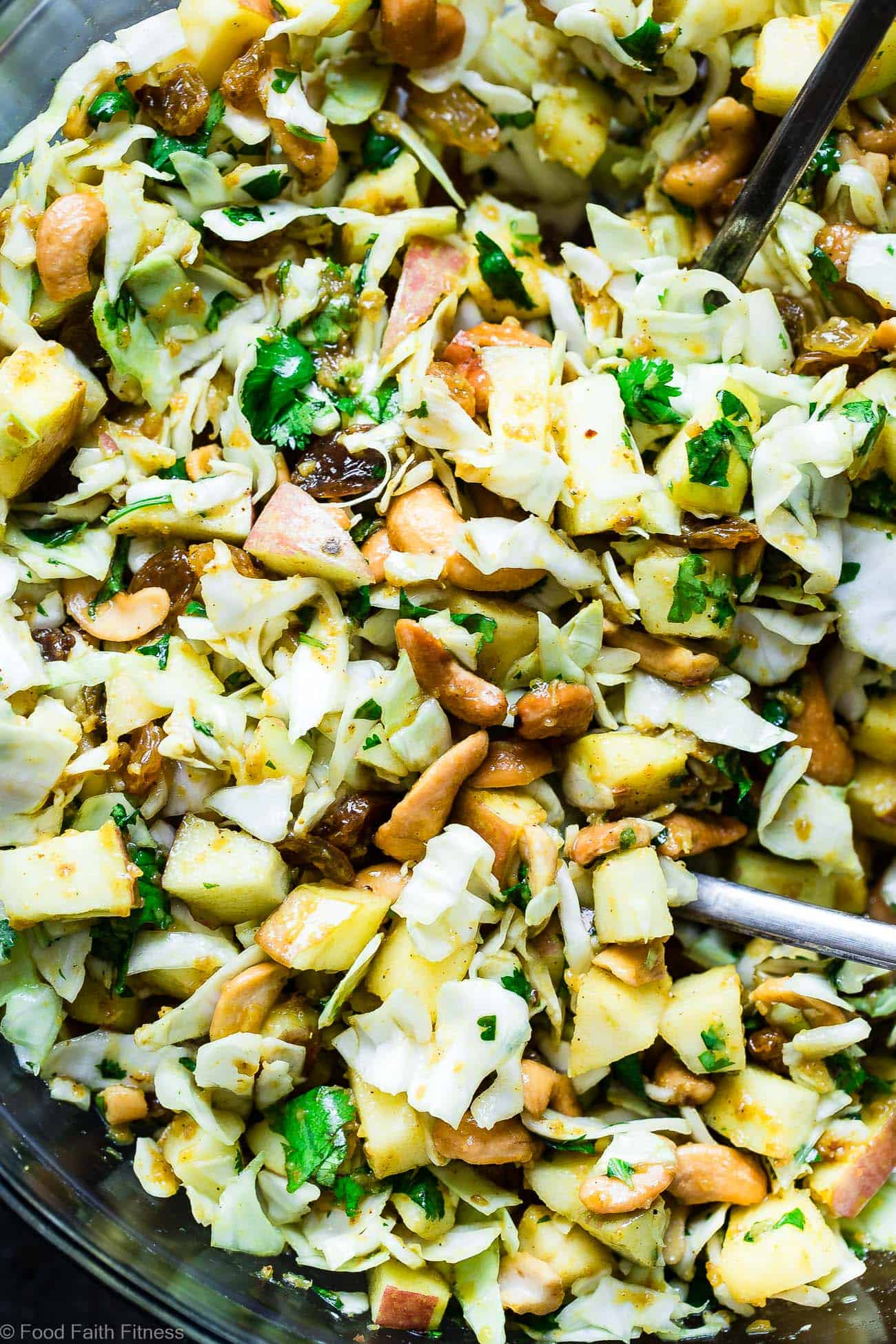 Curry Cashew Shredded Cabbage Salad with Apples - A sugar and gluten free healthy raw cabbage salad that is mixed with a creamy curry dressing and crunchy cashews! A healthy, paleo and whole30 side dish that everyone will love! | Foodfaithfitness.com | @FoodFaithFit