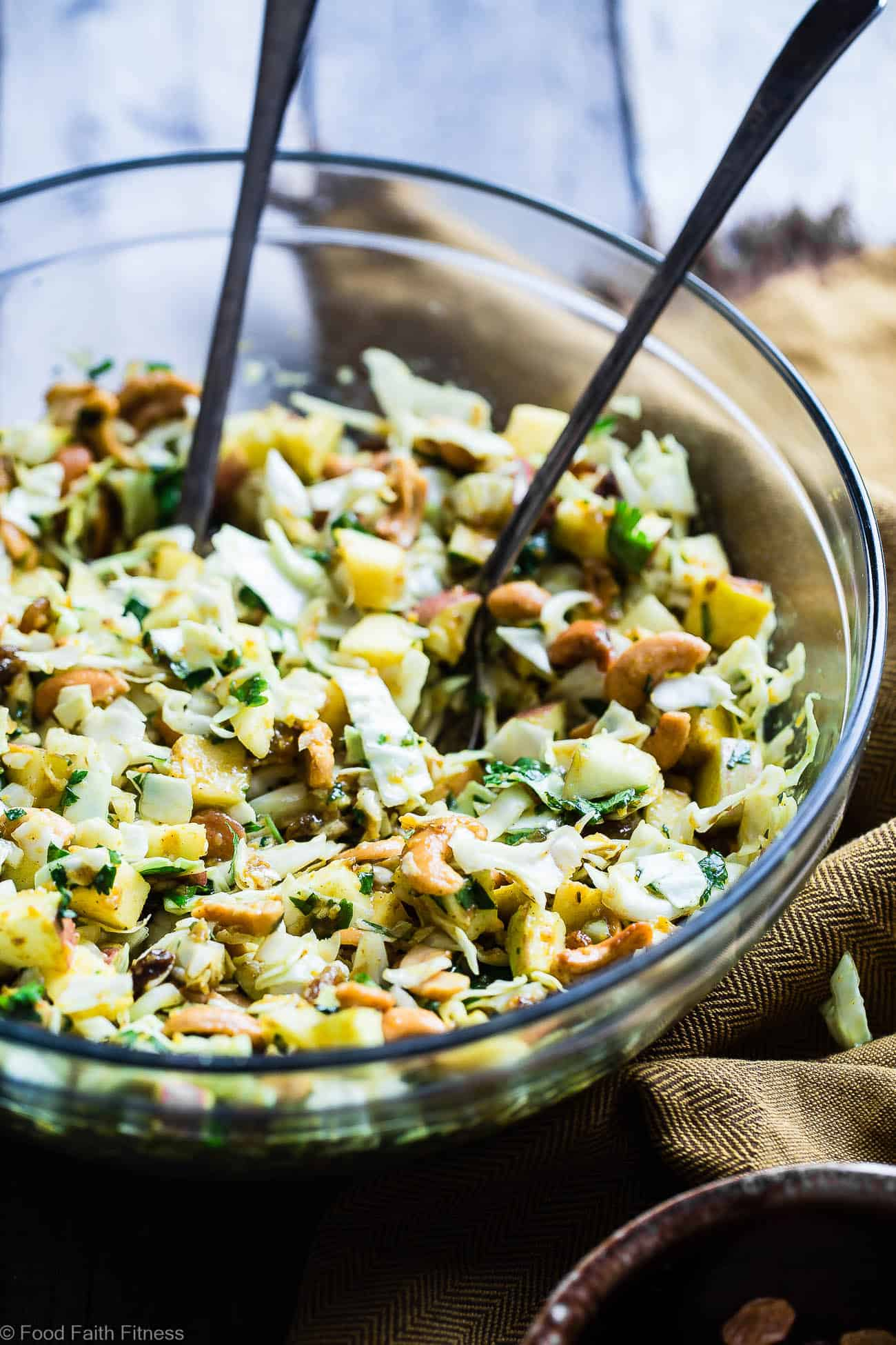 Curry Cashew Shredded Cabbage Salad with Apples - A sugar and gluten free healthy easy cabbage salad recipe that is mixed witha creamy curry dressing and crunchy cashews! A healthy, paleo and whole30 side dish that everyone will love! | Foodfaithfitness.com | @FoodFaithFit