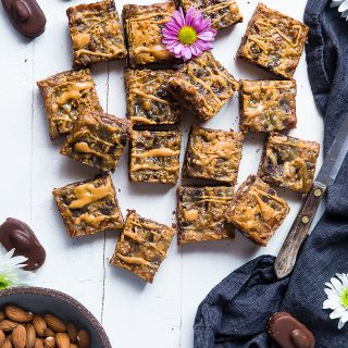 Almond Joy Gluten Free Magic Cookie Bars - These paleo and vegan friendly magic cookie bars taste like an almond joy! They're an easy, healthier spin on a classic treat that you'll never believe is gluten/grain/dairy and refined sugar free! | Foodfaithfitness.com | @FoodFaithFit