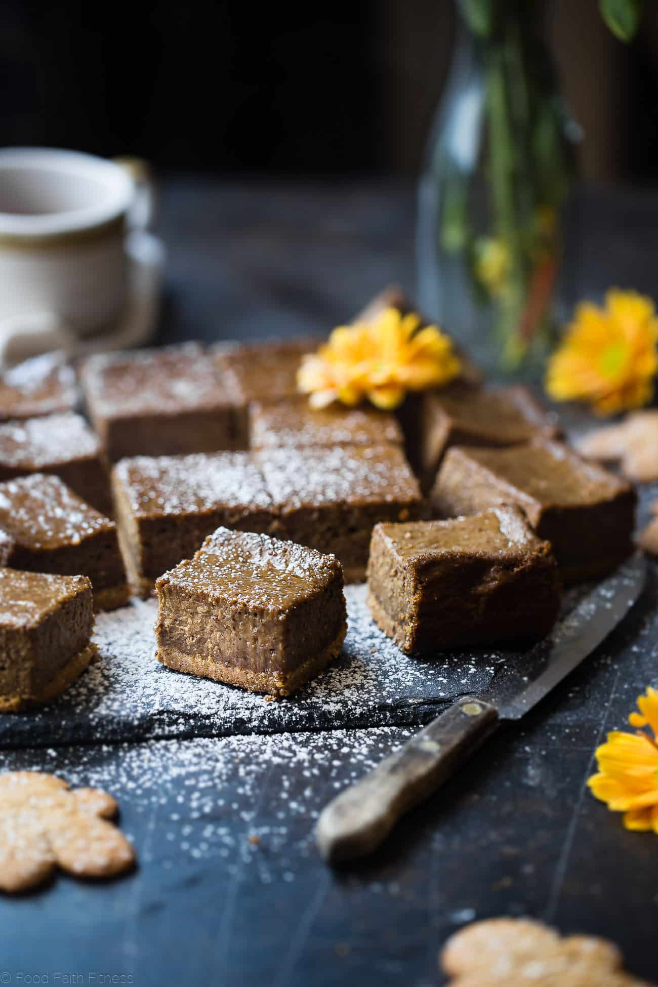 Dairy Free Vegan Coffee Gingerbread Cheesecake Bars - These little bites of gingerbread bliss are SO creamy and spicy-sweet! A paleo friendly, healthy and gluten free dessert for the holidays that you will never believe is dairy and egg free!  | Foodfaithfitness.com | @FoodFaithFit
