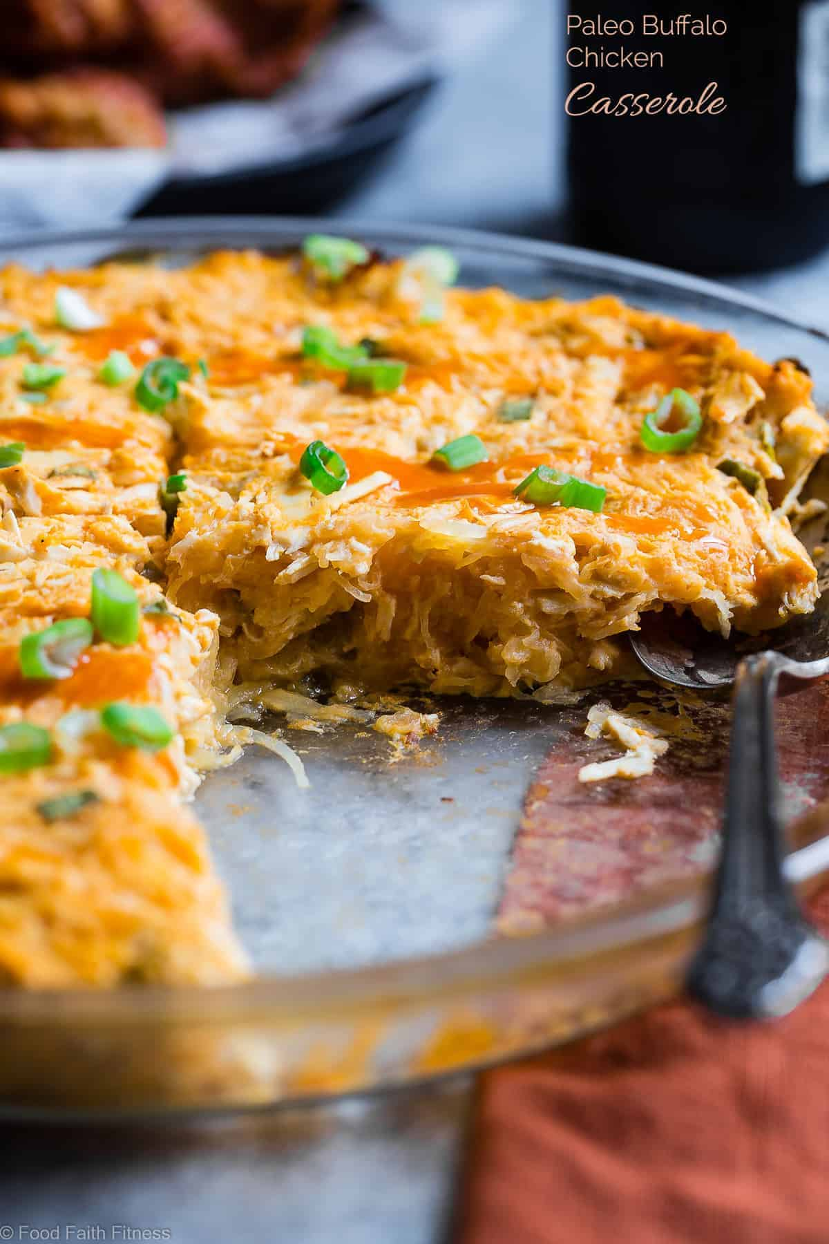 paleo buffalo chicken spaghetti squash casserole on a table with a spoon