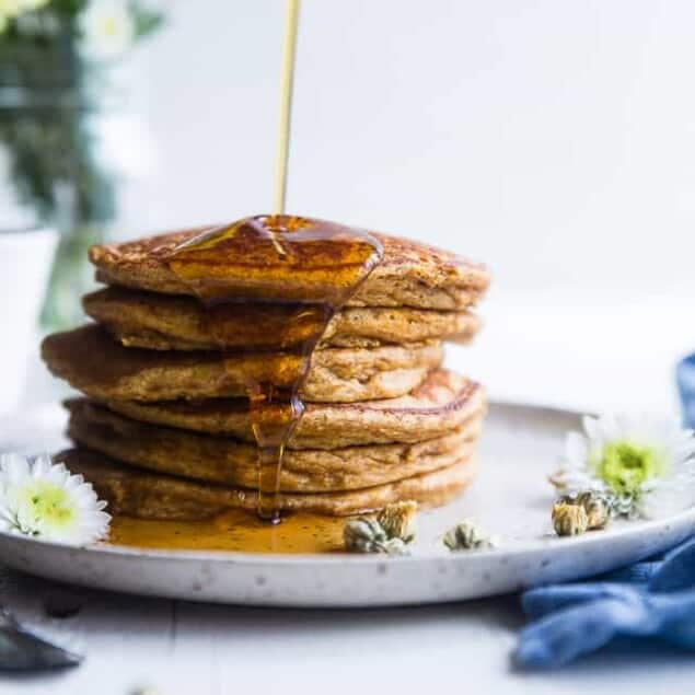 Gluten Free Paleo Sweet Potato Pancakes -SO fluffy and tender that you won't believe they're made without butter or oil! Perfect for a healthy breakfast and freezes great for busy mornings! | #Foodfaithfitness | #Glutenfree #Paleo #Healthy #Dairyfree #Pancakes