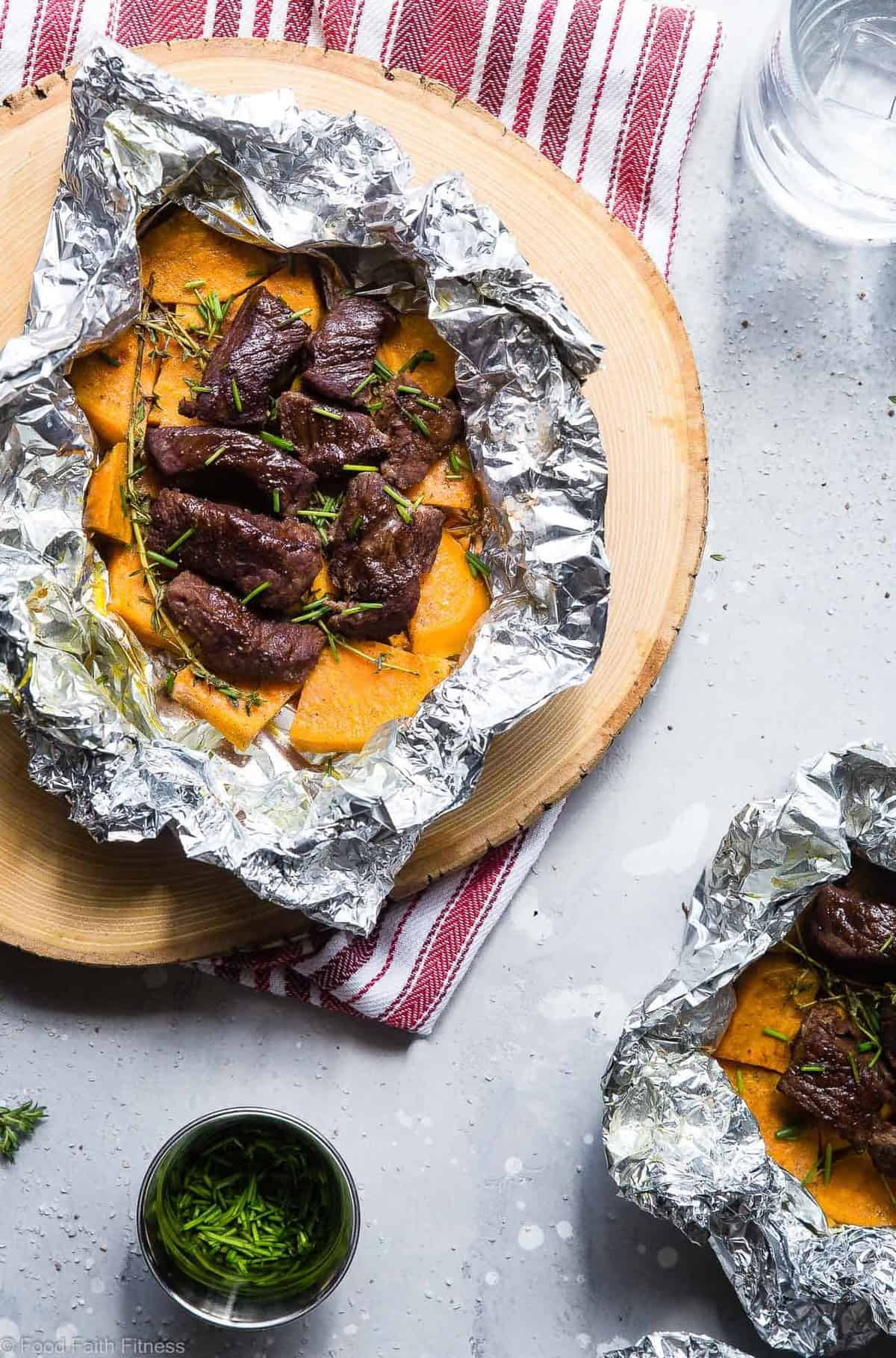 Garlic Steak and Potato Foil Packets -These EASY SteakFoil Packets are an easy, healthy and whole30 approved summer dinner with only 6 ingredients and 300 calories! Sure to please even the pickiest of eaters! | #Foodfaithfitness | #Glutenfree #Paleo #Whole30 #Grilling #Dairyfree