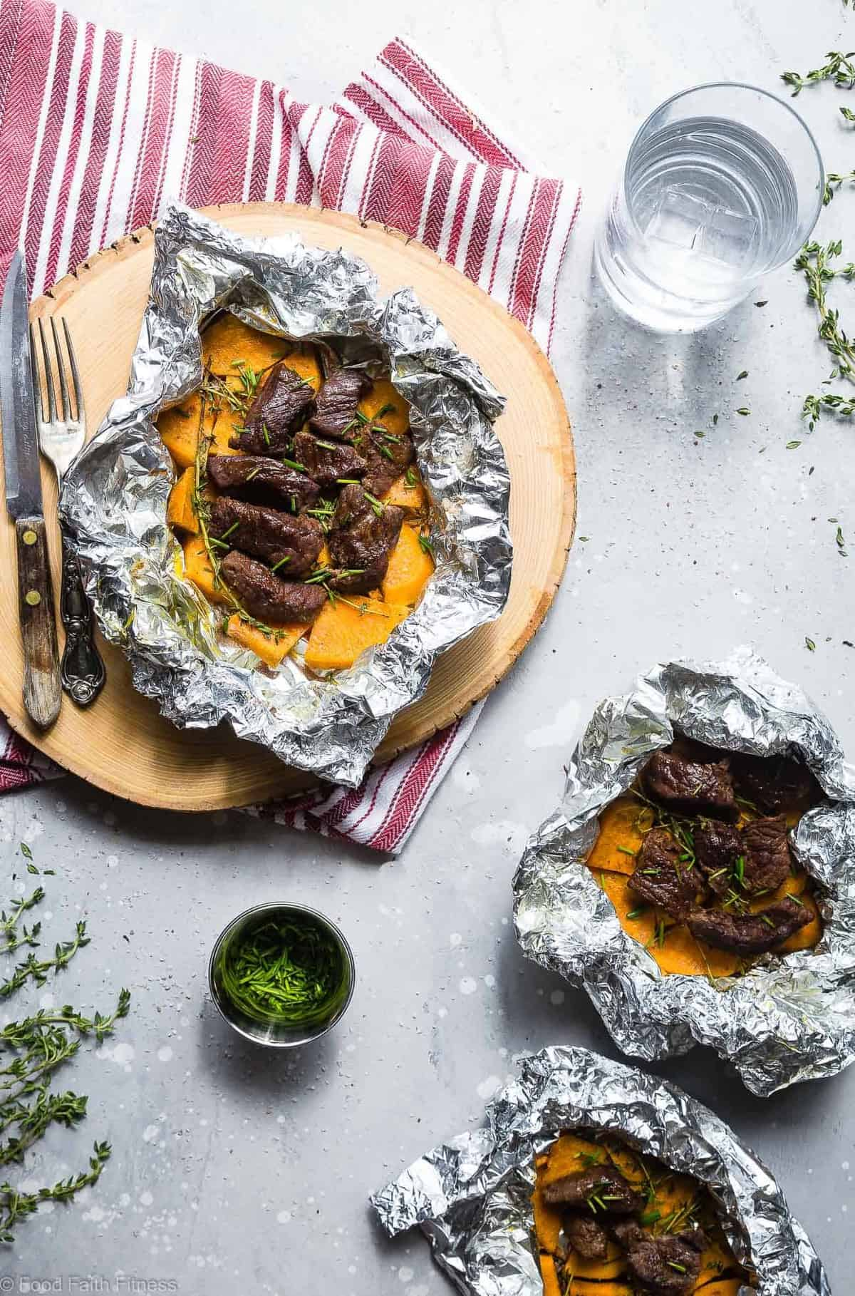 Garlic Steak and Potato Foil Packets - These EASY Steak Foil Packets are an easy, healthy and whole30 approved summer dinner with only 6 ingredients and 300 calories! Sure to please even the pickiest of eaters! | #Foodfaithfitness | #Glutenfree #Paleo #Whole30 #Grilling #Dairyfree