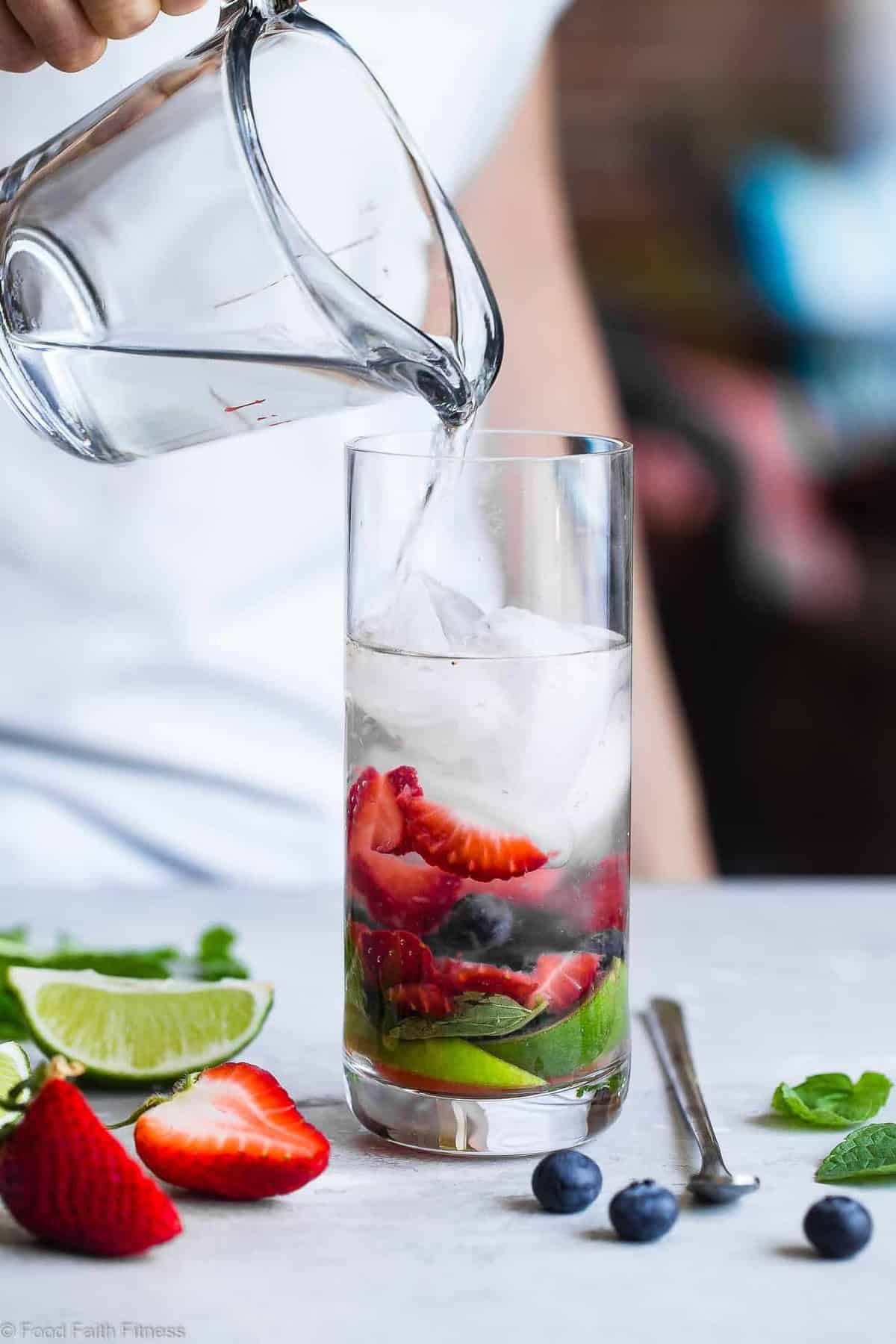 Red White and Blueberry Coconut Mojitos - This strawberry, coconut blueberry mojito recipe is a healthier, gluten free, easy Summer drink with only 130 calories and no sugar! Perfect for July 4th! | #Foodfaithfitness | #Mojito #July4th #Healthy #SugarFree #Glutenfree