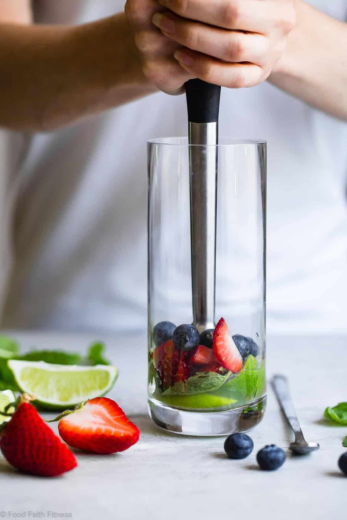 Red White and Blueberry Coconut Mojitos - This coconut blueberry mojito recipe with strawberries is a healthier, gluten free, easy Summer drink with only 130 calories and no sugar! Perfect for July 4th! | #Foodfaithfitness | #Mojito #July4th #Healthy #SugarFree #Glutenfree