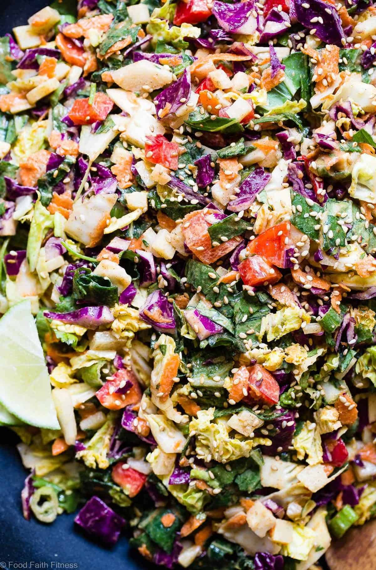 Healthy Oriental Coleslaw with Asian Dressing -This easy, saucy, paleo and vegan friendly coleslawis loaded with spicy-sweet flavors and the perfect crunchy! A great Summer side or topping that is gluten, grain and dairy free! | #Foodfaithfitness | #Glutenfree #Paleo #Vegan #Dairyfree #Coleslaw