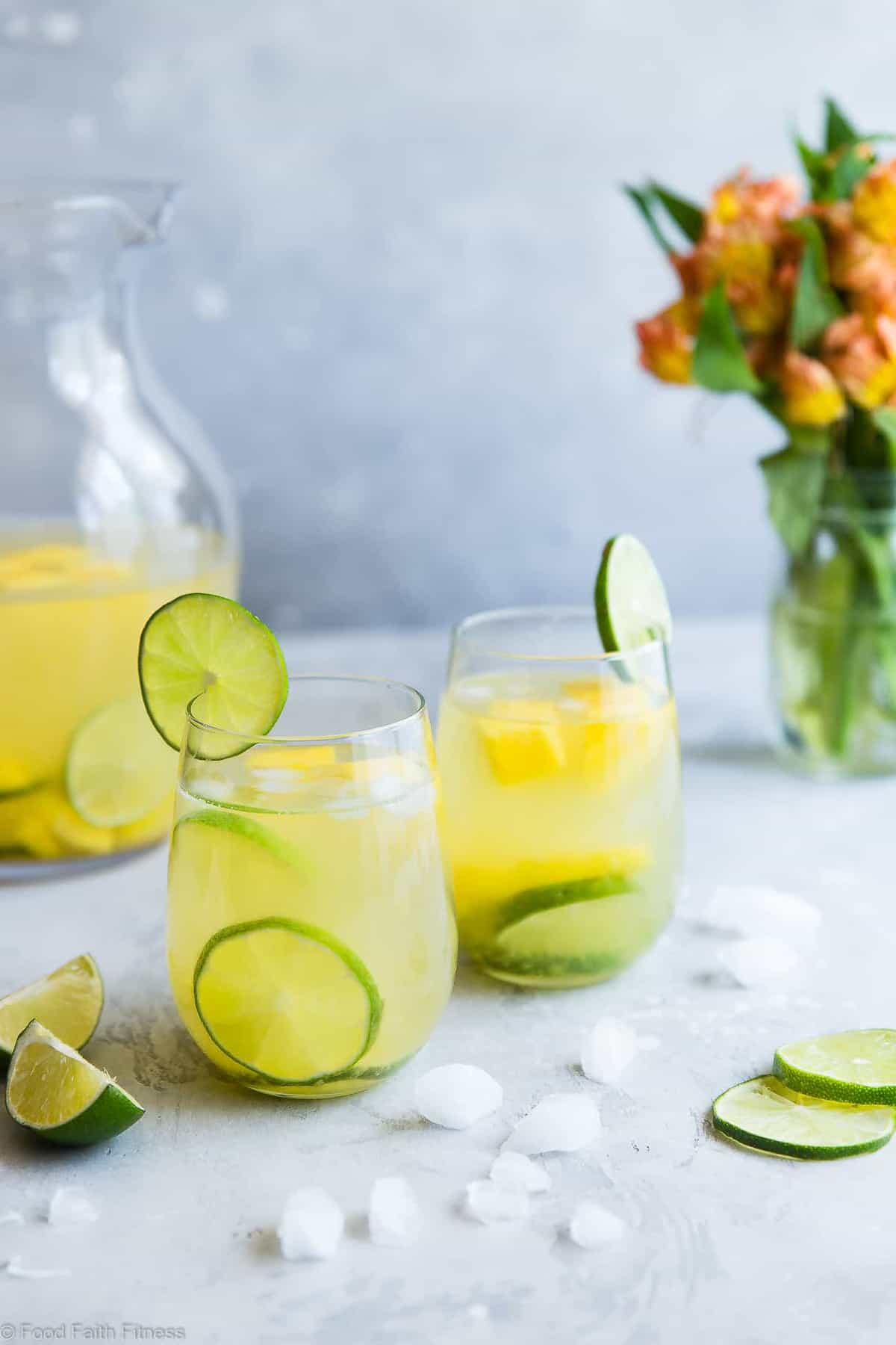 Tropical White Moscato Sangria - This easy, island style White Moscato Sangria recipe is a SUPER easy cocktail, perfect for Summer parties! Made with better for you ingredients and SO tasty! | #Foodfaithfitness | #Sangria #Glutenfree #Healthy #DairyFree #Cocktail