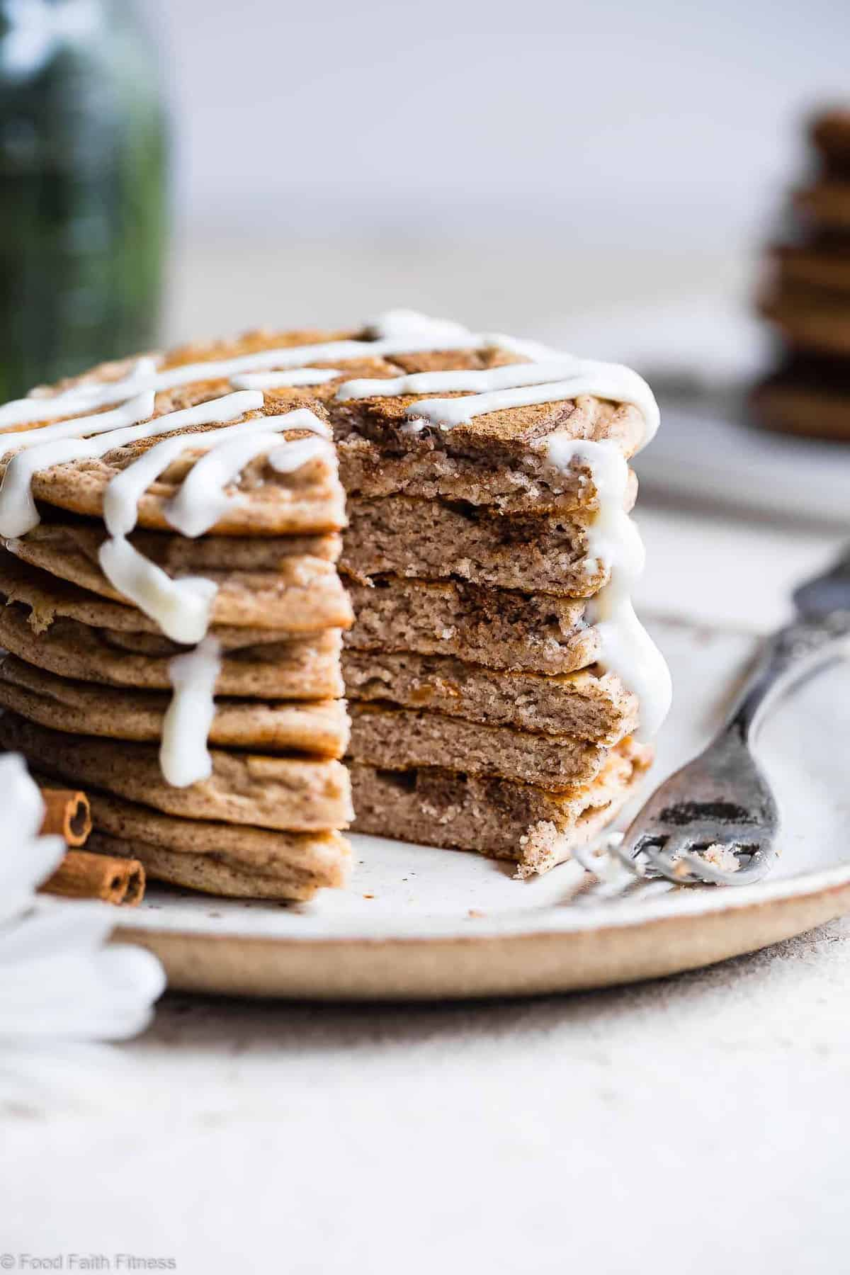 Cinnamon Roll Keto Protein Pancakes -This EASY, low carb, gluten free healthy protein pancakes recipe is going to be your new favorite breakfast! Great for kids and adults and packed with 23g of protein!Who doesn't want to wake up to healthy cinnamon rolls?! | #Foodfaithfitness | #Keto #Lowcarb #Glutenfree #Healthy #Pancakes